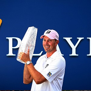 Matt Kuchar poses with the trophy at The Players Championship at TPC Sawgrass.