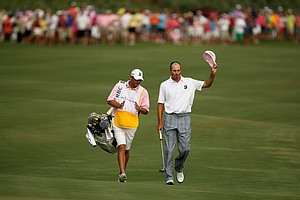 Matt Kuchar walks up No. 18 with his caddie during the final round at The Players Championship at TPC Sawgrass.