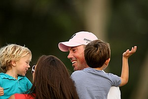 Matt Kuchar with his family, wife Sybi, Carson, 2, left, and Cameron, 4, right after winning the The Players Championship at TPC Sawgrass.