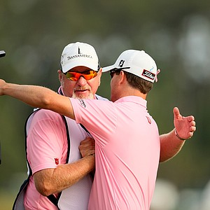 Zach Johnson hugs his caddie Damon Green during the final round at The Players Championship at TPC Sawgrass.