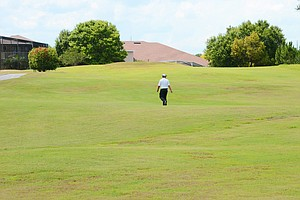 Carl Yuan, 15, walks to the ninth tee at Timacuan Country Club during a U.S. Open local qualifier on Thursday, May 17, 2012. Yuan would par the ninth to win a four-man playoff for the last of four spots in the sectionals.