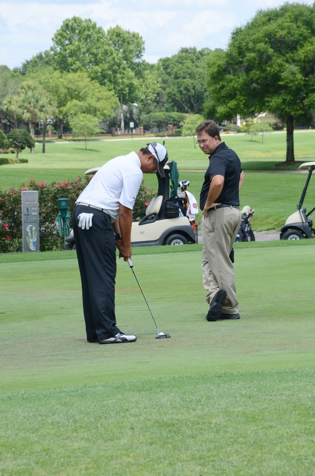 Carl Yuan, 15, on the putting green with mental performance coach, Bill Nelson, prior to the four-man playoff at a U.S. Open local qualifier at Timacuan Country Club in Lake Mary, Fla.