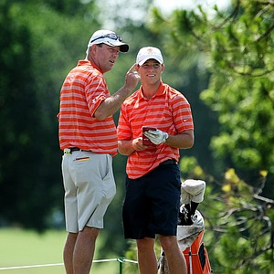 Illinois head coach Mike Small talks with Luke Guthrie at the turn during the final round of the Southwest Regional Championship at Jimmie Austin Golf Club in Norman, Oklahoma.