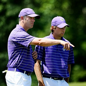Washington's Matt Thurmond with Chris Williams, who also placed as the top individual, during the final round of the Southwest Regional Championship at Jimmie Austin Golf Club in Norman, Oklahoma.