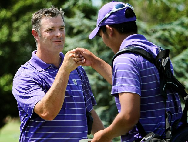 Washington's head coach Matt Thurmond fist bumps his last player of the day, Cheng-Tsung Pan after they won during the final round of the Southwest Regional Championship at Jimmie Austin Golf Club.