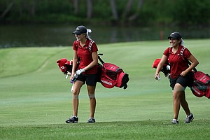 Arkansas' Emma Lavy, left, and Victoria Vela, right, during the practice round at the 2012 NCAA Division I Women's Golf Championships at Vanderbilt Legends Club North Course in Franklin, Tenn.