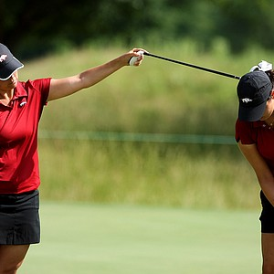 Arkansas head coach Shauna Estes-Taylor works with Emily Tubert on the practice green Tuesday at the 2012 NCAA Division I Women's Golf Championships at Vanderbilt Legends Club North Course in Franklin, Tenn.