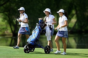UCLA's head coach Carrie Forsyth walks with assistant Alicia Um-Holmes and Tiffany Lua during the practice round at the 2012 NCAA Division I Women's Golf Championships at Vanderbilt Legends Club North Course in Franklin, Tenn.