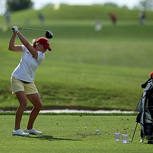 Former Arkansas player, LPGA's Stacy Lewis gets in a little practice while watching the Razorbacks practice at the 2012 NCAA Division I Women's Golf Championships at Vanderbilt Legends Club North Course in Franklin, Tenn.