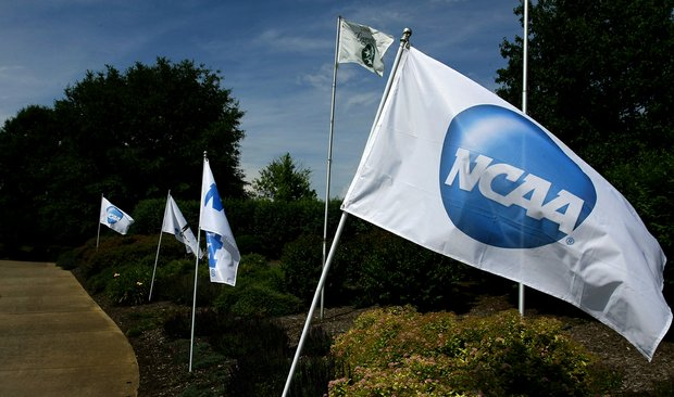 NCAA flags fly around the practice green at the 2012 NCAA Division I Women's Golf Championships at Vanderbilt Legends Club North Course in Franklin, Tenn.