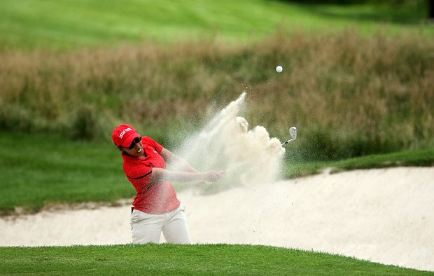 Gabriella Dominguez of Texas Tech hits out of a greenside bunker during the 2012 NCAA Division I Women's Golf Championships.