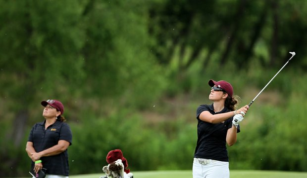 Giulia Molinaro of Arizona State hits a shot at No. 18 as assistant Missy Farr-Kaye watches on Tuesday at the 2012 NCAA Division I Women's Golf Championships at Vanderbilt Legends Club North Course in Franklin, Tenn.