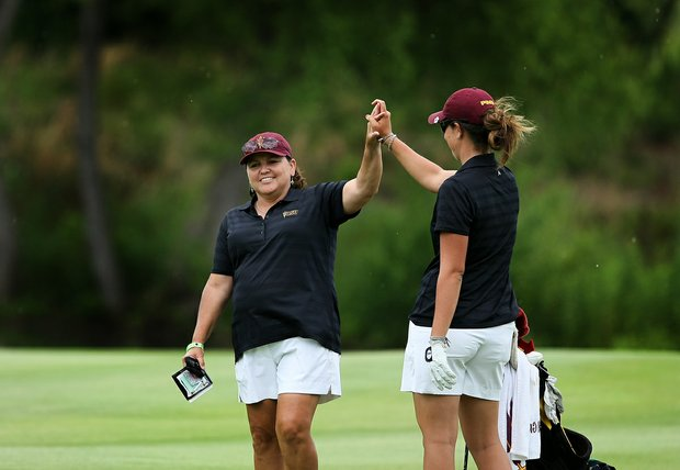 Arizona State assistant coach Missy Farr-Kaye high-fives Giulia Molinaro at No. 18 on Tuesday at the 2012 NCAA Division I Women's Golf Championships.