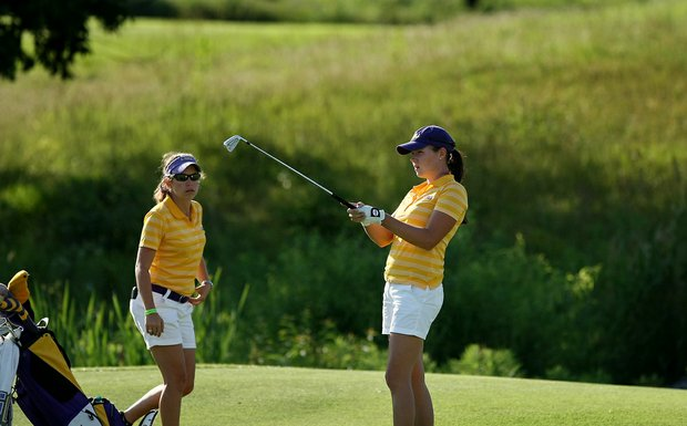 LSU's Tessa Teachman, right, with assistant Alexis Rather, left, on Tuesday at the 2012 NCAA Division I Women's Golf Championships.