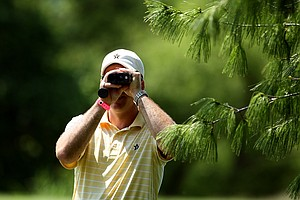 Vanderbilt head coach, Greg Allen, watches the shot of Lauren Stratton at No. 17 on Wednesday at the 2012 NCAA Division I Women's Golf Championships.