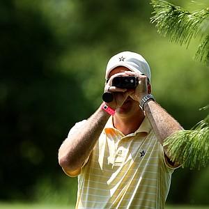 Vanderbilt head coach, Greg Allen, watches the shot of Lauren Stratton at No. 17 on Wednesday at the 2012 NCAA Division I Women's Golf Championships.