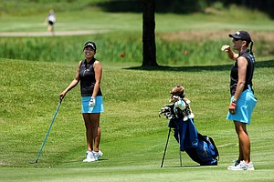 UCLA's Brianna Do with head coach Carrie Forsyth on Wednesday at the 2012 NCAA Division I Women's Golf Championships.