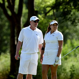Duke head coach Dan Brooks talks with his player Alejandra Cangrejo at No. 17 on Wednesday at the 2012 NCAA Division I Women's Golf Championships.