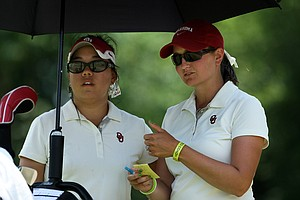 Oklahoma head coach, Veronique Drouin-Lutrell talks with Chirapat Jao-Javanil at No. 16 on Thursday. Jao-Javanil is tied for the lead after Round 3.