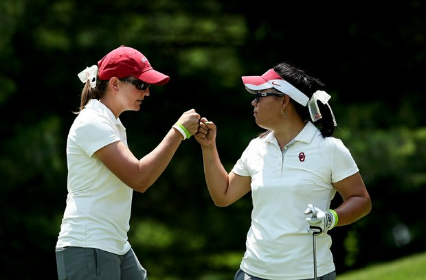 Oklahoma head coach, Veronique Drouin-Lutrell fist bumps with Chirapat Jao-Javanil at No. 16 on Thursday at the 2012 NCAA Division I Women's Golf Championships. Jao-Javanil shot a 70 in her third round.