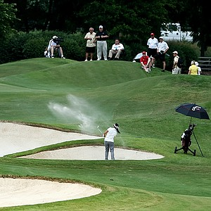 Chirapat Jao-Javanil of Oklahoma hits out of a bunker at No. 17 on Thursday at the 2012 NCAA Division I Women's Golf Championships.