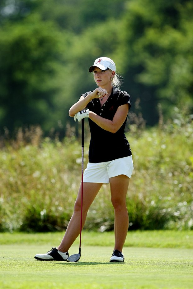 Alabama's Brooke Pancake waits for the fairway to clear at No. 7 during a short backup on Thursday at the 2012 NCAA Division I Women's Golf Championships.