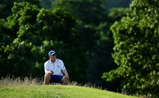 Duke head coach Dan Brooks watches from afar on Thursday at the 2012 NCAA Division I Women's Golf Championships at Vanderbilt Legends Club North Course in Franklin, Tenn.