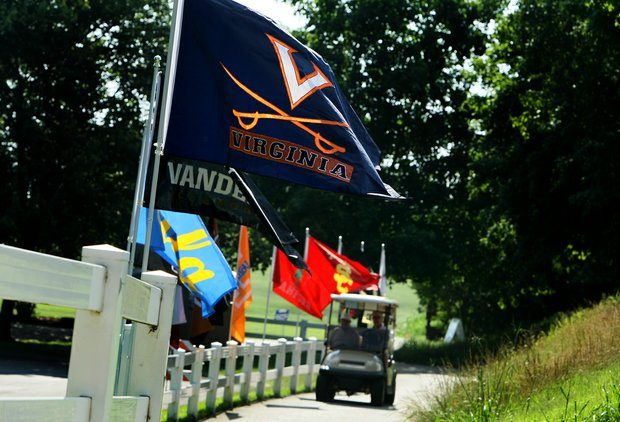College flags fly on Thursday at the 2012 NCAA Division I Women's Golf Championships.