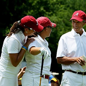 Alabama head coach Mic Potter, right, and assistant Susan Rosenstiel, left, talk with their first player off the tee, Courtney McKim, during the final round of the 2012 NCAA Division I Women's Golf Championships.