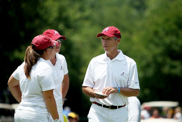 Alabama head coach Mic Potter talks with first player off the tee for the day, Courtney McKim, during the final round of the 2012 NCAA Division I Women's Golf Championships.