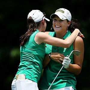 Diana Cantu, assistant coach for Baylor hugs her player, Jaclyn Jansen after she made a hole in one at No. 16  during the final round of the 2012 NCAA Division I Women's Golf Championships.