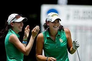Baylor assistant coach Diana Cantu, left, and her player Jaclyn Jansen after Jansen aced the 16th hole during the final round of the 2012 NCAA Division I Women's Golf Championships.