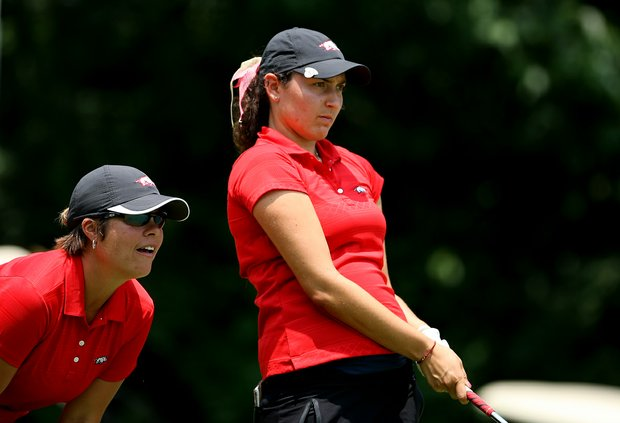 Arkansas Emily Tubert, right, and head coach Shauna Estes-Taylor closely watch the ball at No. 16 during the final round of the 2012 NCAA Division I Women's Golf Championships.