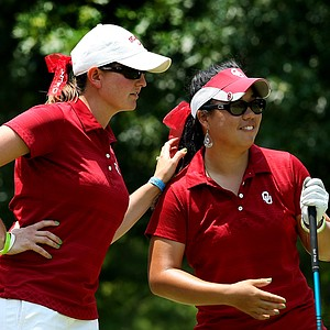 Oklahoma head coach Veronique Drouin-Lutrell with Chirapat Jao-Javanil as she tees off during the final round of the 2012 NCAA Division I Women's Golf Championships.