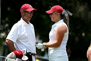 Alabama head coach Mic Potter talks with Hannah Collier during the final round of the 2012 NCAA Division I Women's Golf Championships.