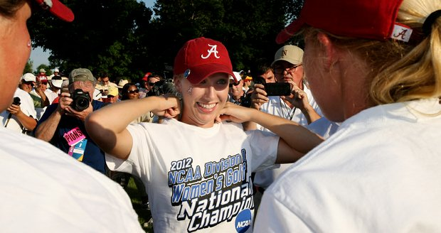 Alabama's Brooke Pancake puts on her championship T-shirt after the Crimson Tide won the 2012 NCAA Division I Women's Golf Championship by one stroke.
