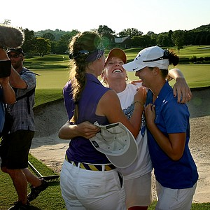 Fellow Curtis Cup players Austin Ernst of LSU (left) and Lindy Duncan of Duke (right) congratulate Alabama's Brooke Pancake on the Crimson Tide's victory in the 2012 NCAA Division I Women's Golf Championship at Franklin, Tenn.
