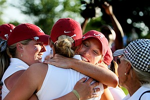 Brooke Pancake hugs her teammates after coming out of the scorers tent at the 2012 NCAA Division I Women's Golf Championships. Pancake lead her team to victory over University of Southern California.
