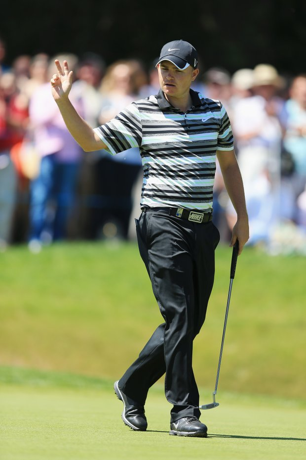 James Morrison acknowledges the crowd after holing an eagle putt on the 18th green during the second round of the BMW PGA Championship on the West Course at Wentworth.