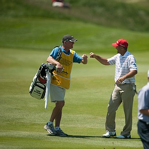 Tom Byrum and his caddie celebrate Byrum's eagle on nine during the second round of play at the 73rd Senior PGA Championship, presented by KitchenAid held at Harbor Shores in Benton Harbor, Michigan, USA, on Friday, May 25, 2012.