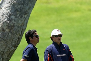 PGA Tour player Jason Dufner, right, watches the action from Round 1 during the 2012 NCAA Championship at Riviera Country Club in Pacific Palisades, Calif.