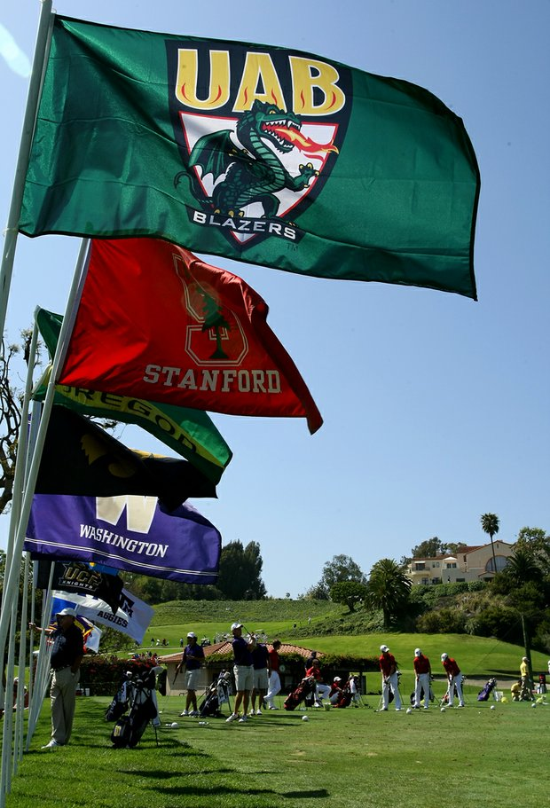 College flags fly on the driving range during the 2012 NCAA Championship at Riviera Country Club in Pacific Palisades, Calif.