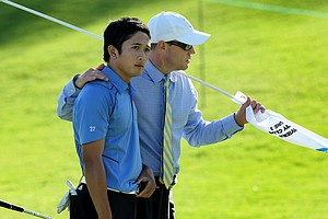 UCLA head coach Derek Freeman, right, with Anton Arboleda during the 2012 NCAA Championship at Riviera Country Club in Pacific Palisades, Calif.