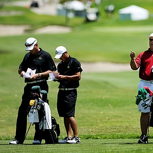 Oregon head coach Casey Martin, left, with Jonathan Woo and Stanford head coach, Conrad Ray with Steven Kearney at No. 14 during the 2012 NCAA Championship. Stanford and Texas are at risk to not make match play.