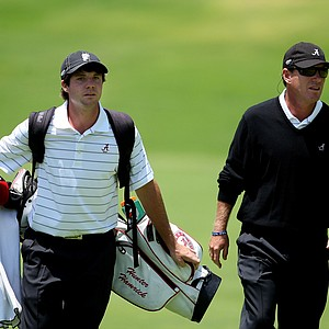Alabama head coach Jay Seawell and Hunter Hamrick walk up No. 18 during the 2012 NCAA Championship at Riviera Country Club. Alabama has the team lead.