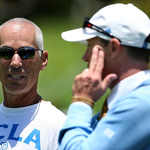 PGA Tour player Corey Pavin talks with UCLA head coach Derek Freeman during Round 2.