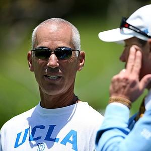 PGA Tour player Corey Pavin talks with UCLA head coach Derek Freeman during Round 2.