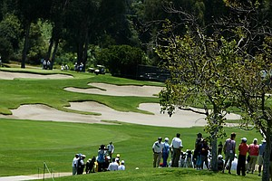 Spectators can sit on a hill behind nine green and watch 10 green as well during the 2012 NCAA Championship.
