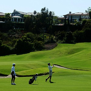 Chris Brant of Iowa hits a shot at No. 9 with homes looming in the background during the 2012 NCAA Championship at Riviera Country Club in Pacific Palisades, Calif.