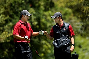 Stanford's Andrew Yun and assistant coach Phil Rowe during the final round of stroke play at the 2012 NCAA Championship.